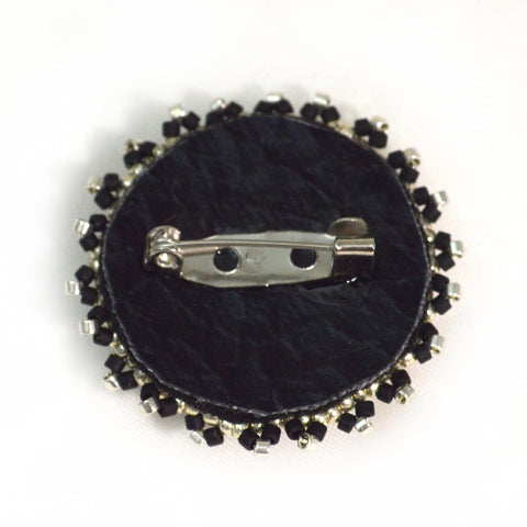 back side of beaded brooch with glass eye beading tutorial
