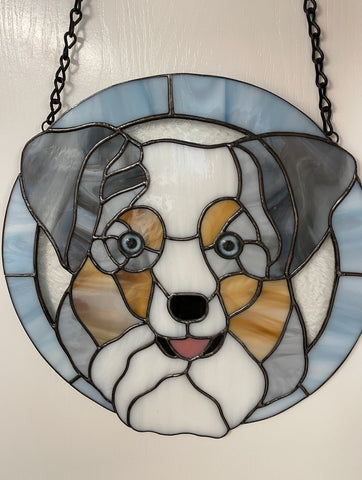 stained glass dog with blue glass eyes