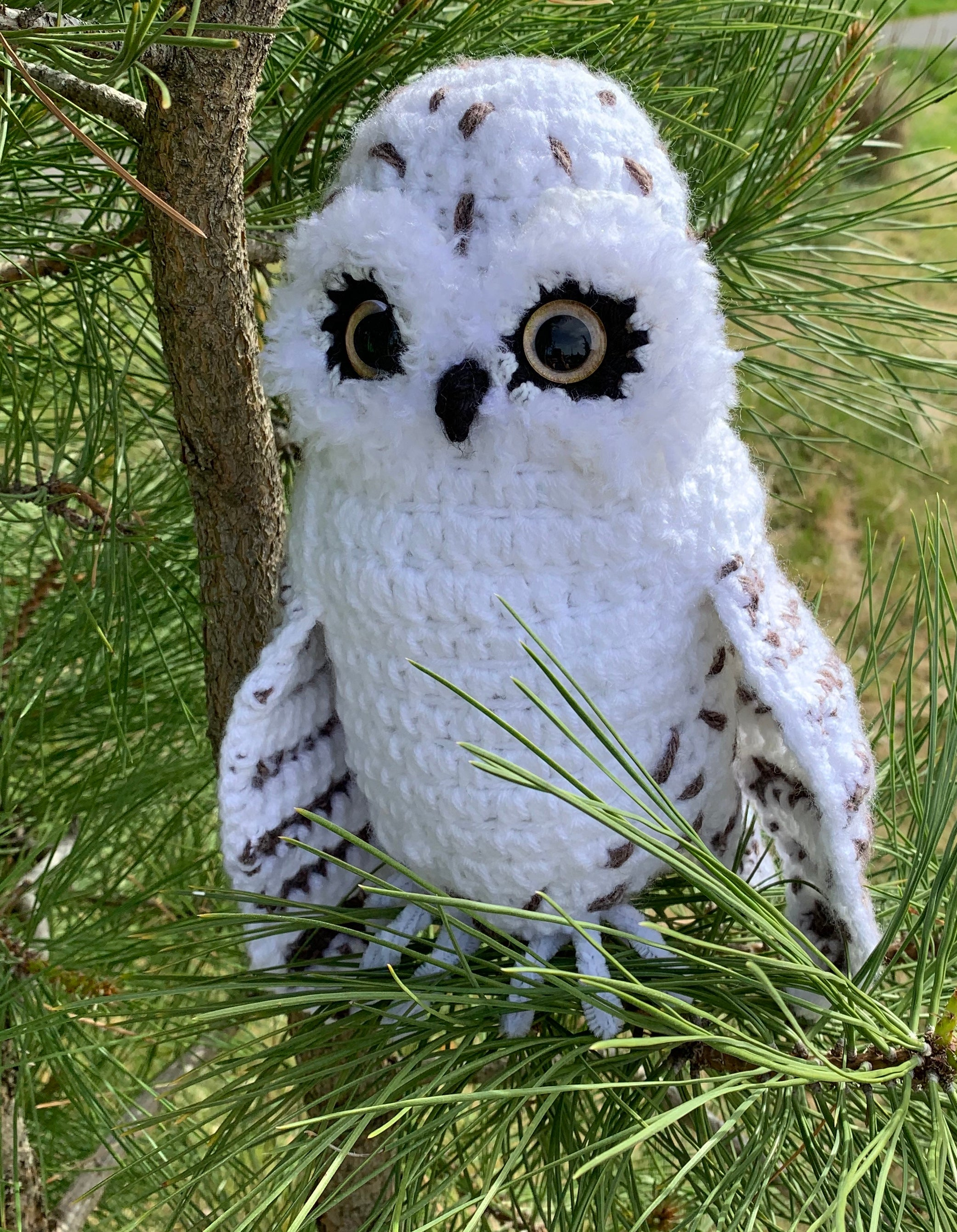white and speckled handmade owl toy with plastic safety eyes
