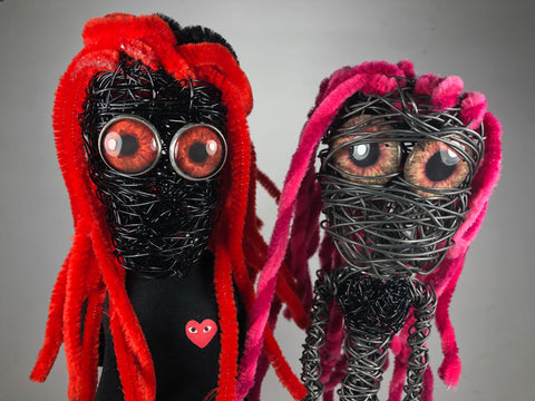 wire sculptures with glass eyes