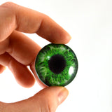 green human glass eye