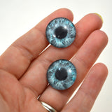 blue human glass eye