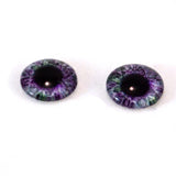 purple and green glass eyes