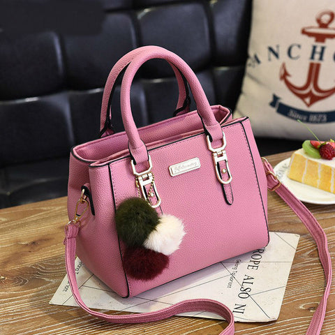 Image of Luxury Handbag with decorative fur