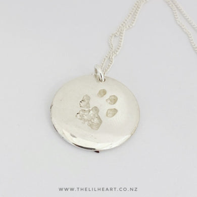 round paw print necklace dog and cat paw prints made in New Zealand in Sterling Silver