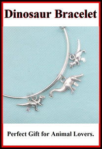 Stunning Dinosaur Charms Handcrafted Expendable Bangle Bracelet.