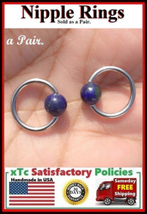 "PAIR Sterilized Surgical Steel 1/2"" Nipple Rings with Lapis Lazuli Balls."