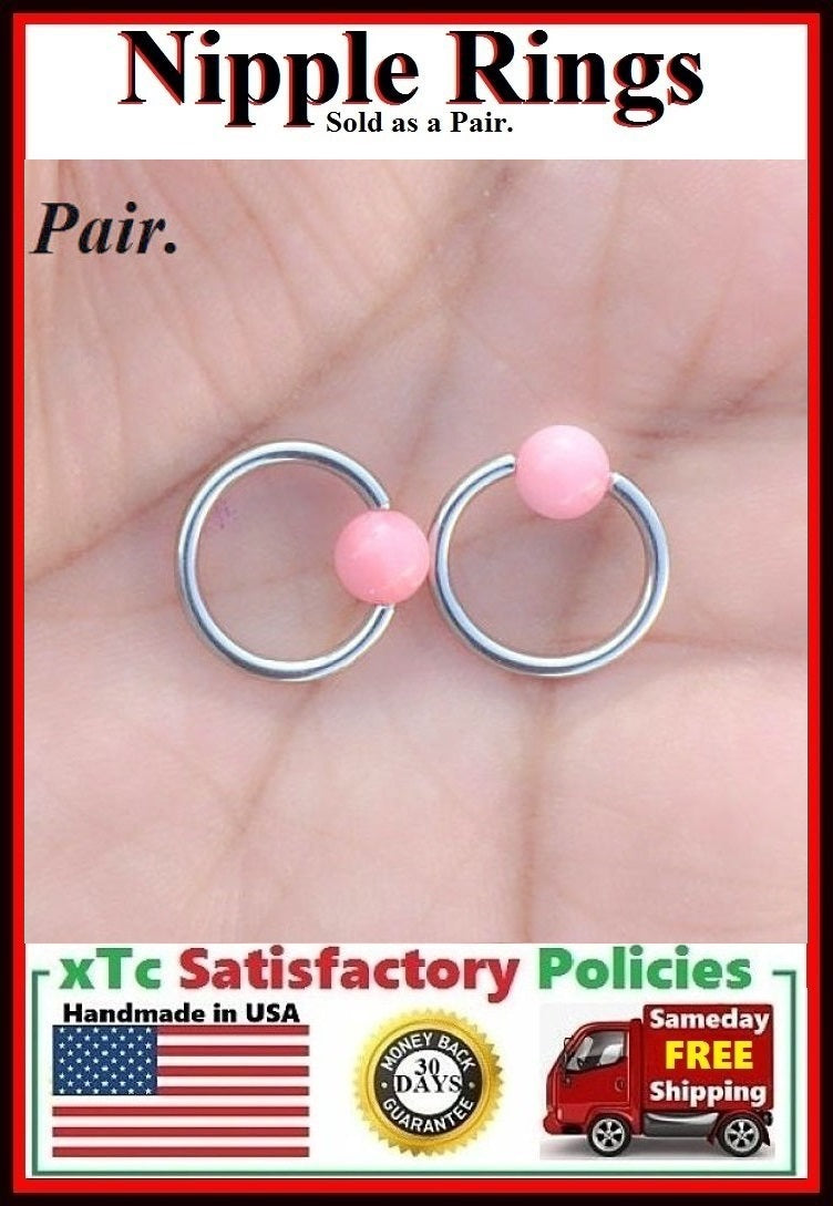 "PAIR Sterilized Surgical Steel 1/2"" Nipple Rings with Pink Coral Balls."