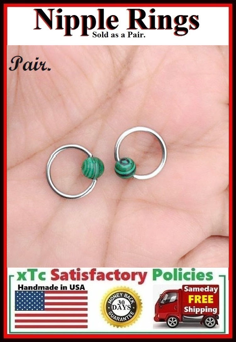 "PAIR Sterilized Surgical Steel 1/2"" Nipple Rings with Malachite Balls."