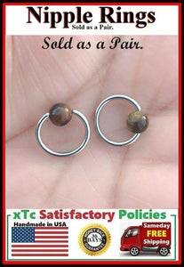 "PAIR Sterilized Surgical Steel 1/2"" Nipple Rings with Tiger Eye Balls."