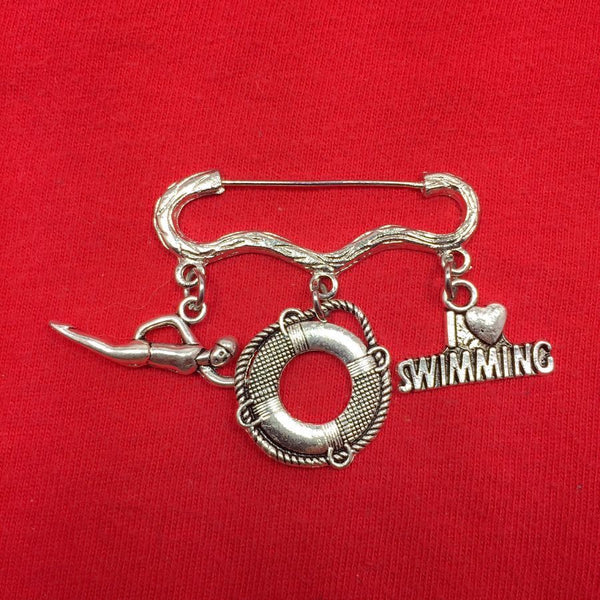 Easy on/off Brooch with Swimmer, Life Ring and Love Swimming Charms.