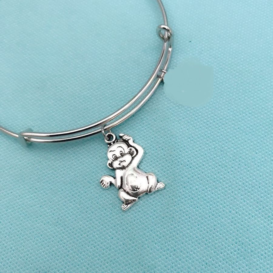 Beautiful MONKEY Silver Charms Expendable Bangle