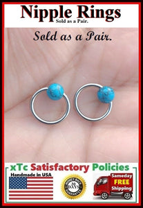 "PAIR Sterilized Surgical Steel 1/2"" Nipple Rings with Turquoise Balls."