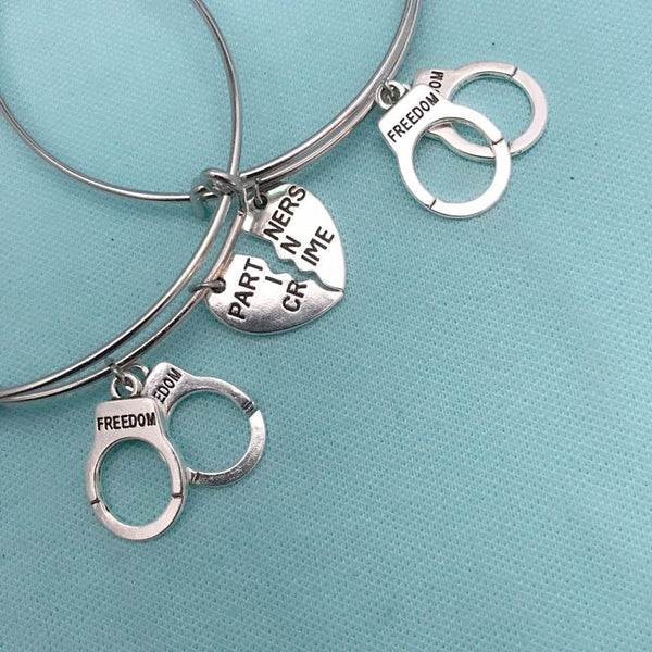 Handcuff & PARTNERS in CRIME Charms Set of 2 Bangles.