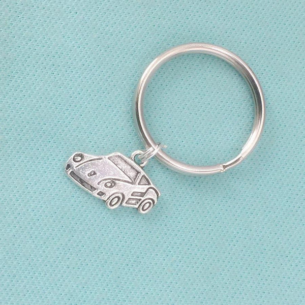 PORSCHE LOVERS: Silver Porsche Model Car Charm Key Ring.