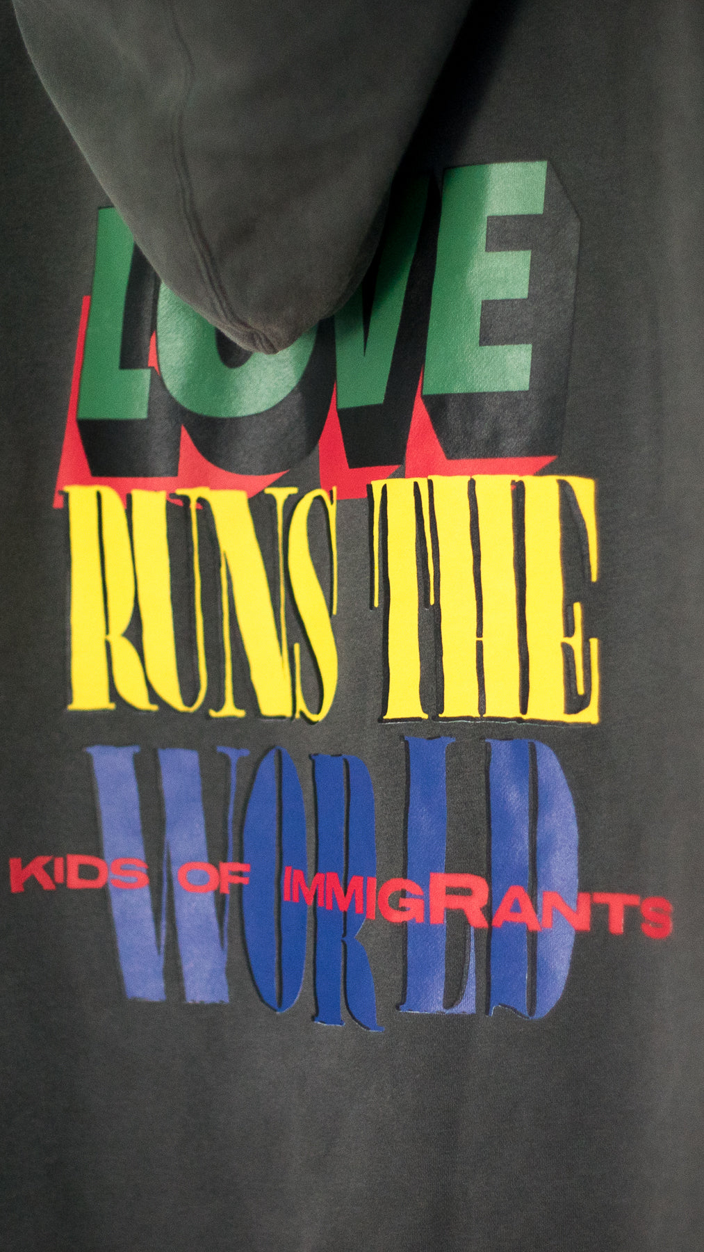 LOVE RUNS THE WORLD HOODIE - VINTAGE BLACK