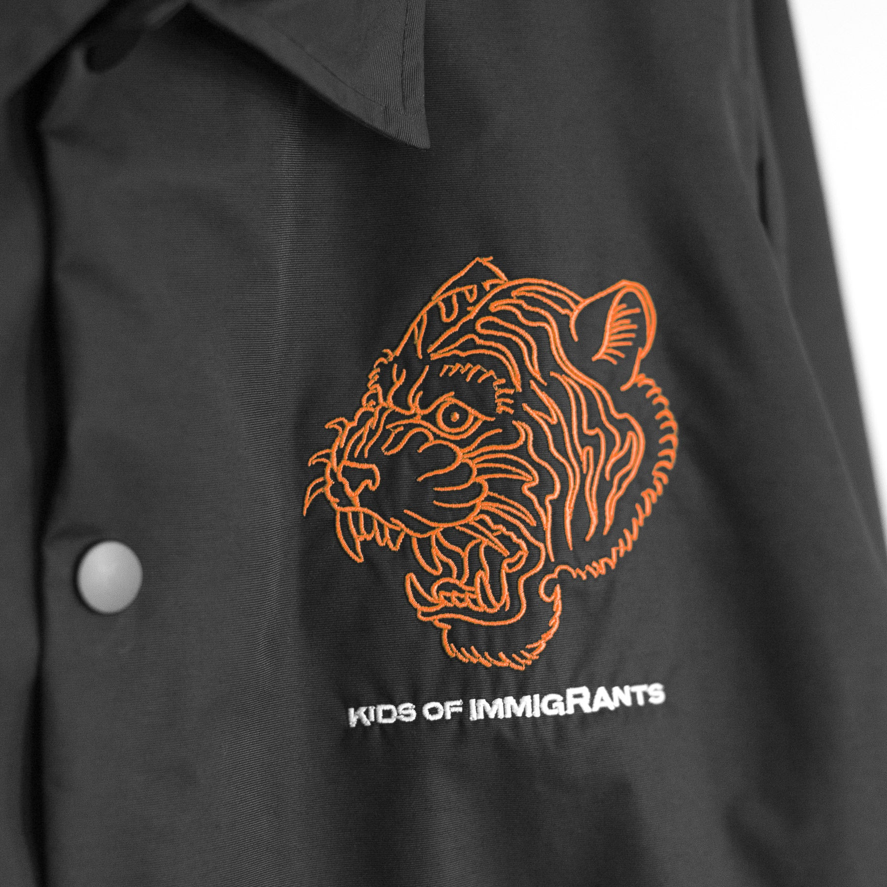 KIDS OF IMMIGRANTS COACH JACKET - BLACK