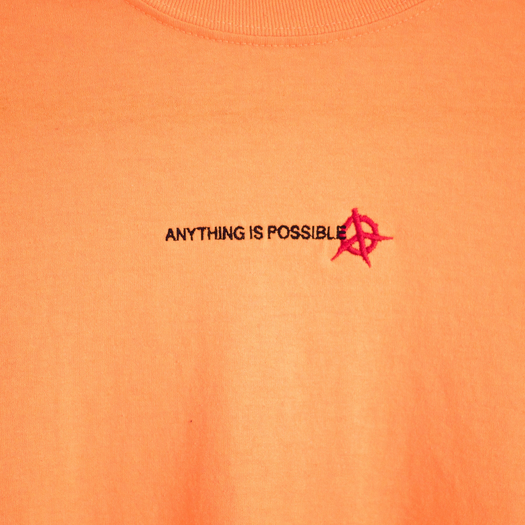 ANYTHING IS POSSIBLE YOUTH ESSENTIAL T-SHIRT - ORANGE
