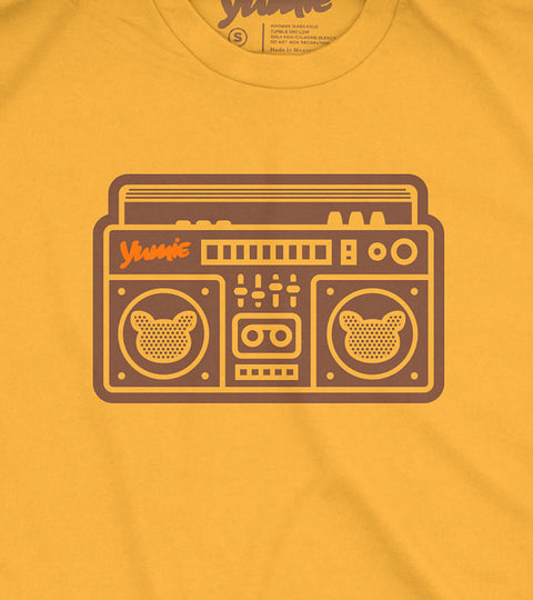 Golden t-shirt with yumie boombox graphic