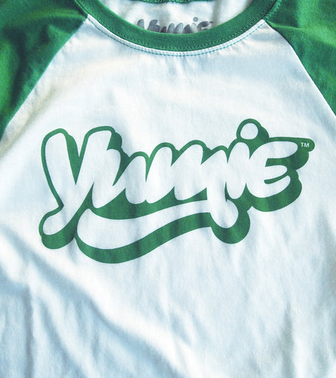 Green and white baseball tee with yumie logo on chest