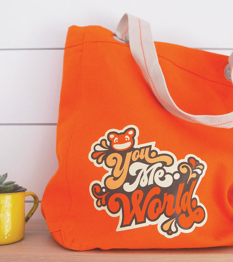 Canvas orange tote bag with yumie world design