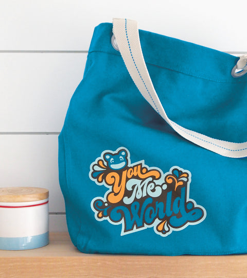 Turquoise canvas tote bag with seventies inspired yumie design
