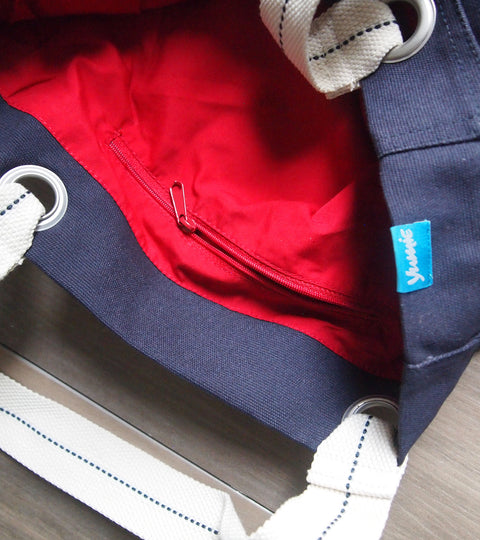Navy canvas tote bag with chili red interior pocket and yumie logo tag