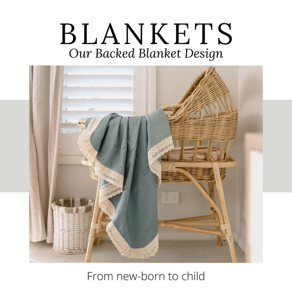 Heritage Blanket mama snuggling a new born baby in a keepsake blanket