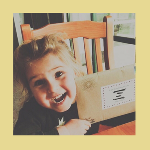 Happy child excited to receive a traditional letter via traditional post