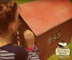 snail mail for kids - child peeking into a traditional post box