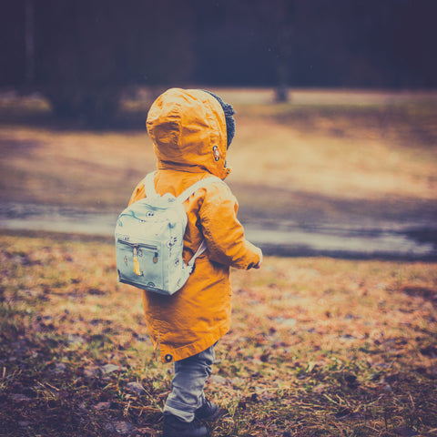 Boy walking ahead alone - Slow Parenting - letting your child discover the world at their own pace