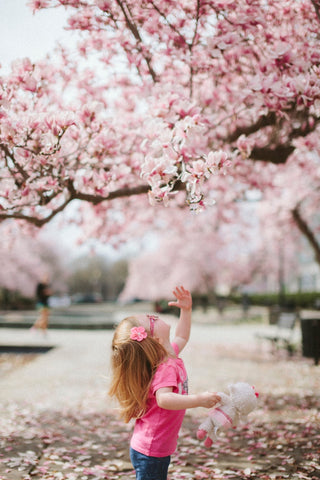 Playing in nature, such as gathering flower petals, is benefical to children
