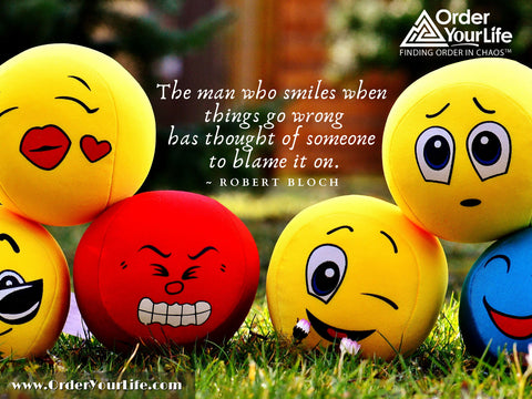 The man who smiles when things go wrong has thought of someone to blame it on. ~ Robert Bloch