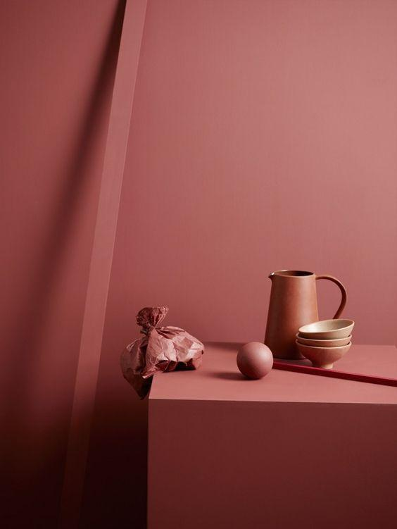 Berry colored ceramic bug with 3 bowls against a berry-colored wall