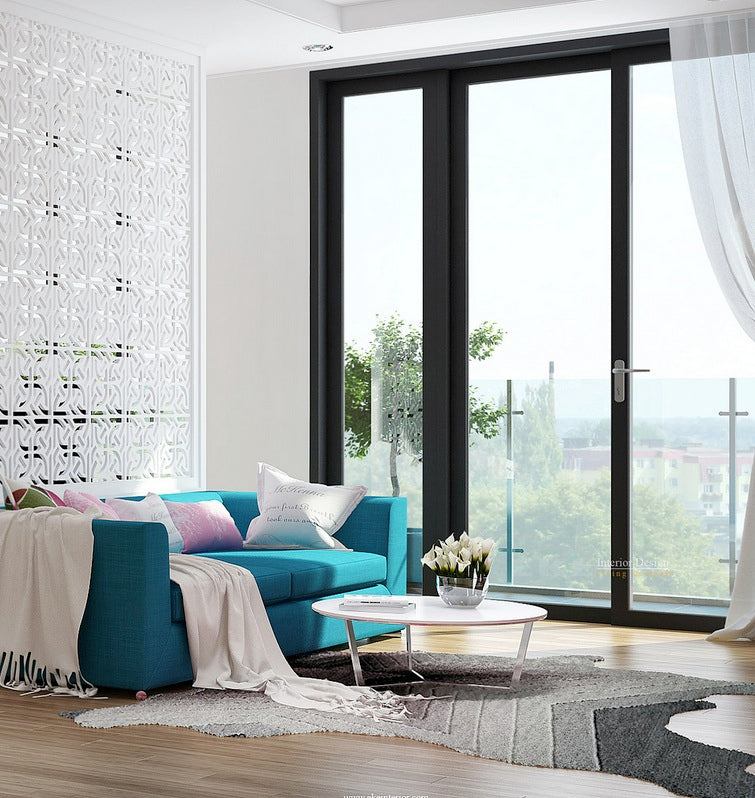 lifestyle image with teal blue couch in a lounge with large glass patio doors