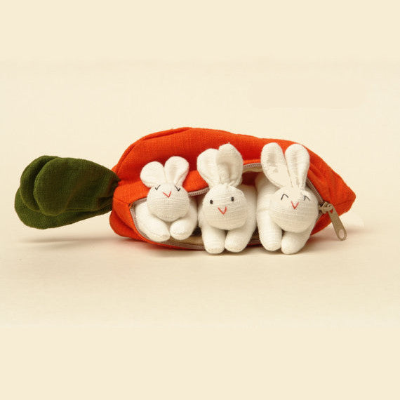 A carrot purse bursting with three bunnies