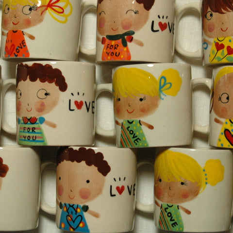 Lovely little hand painted boy and girl mugs
