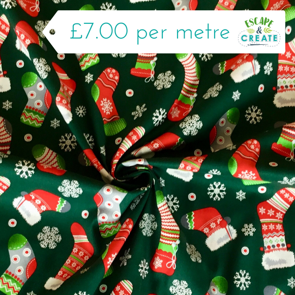 Christmas Stockings on Green Cotton Poplin