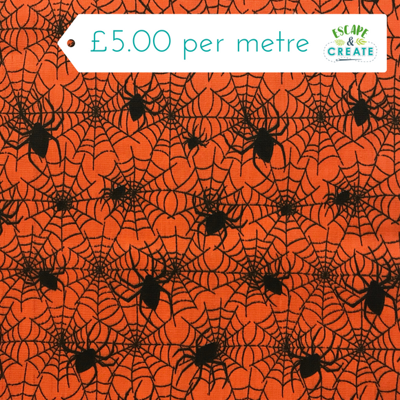 Polycotton Halloween Spiderwebs on Orange