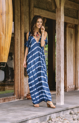 Tie dye maxi dress with cold shoulder cut out sleeves. Deep v neck