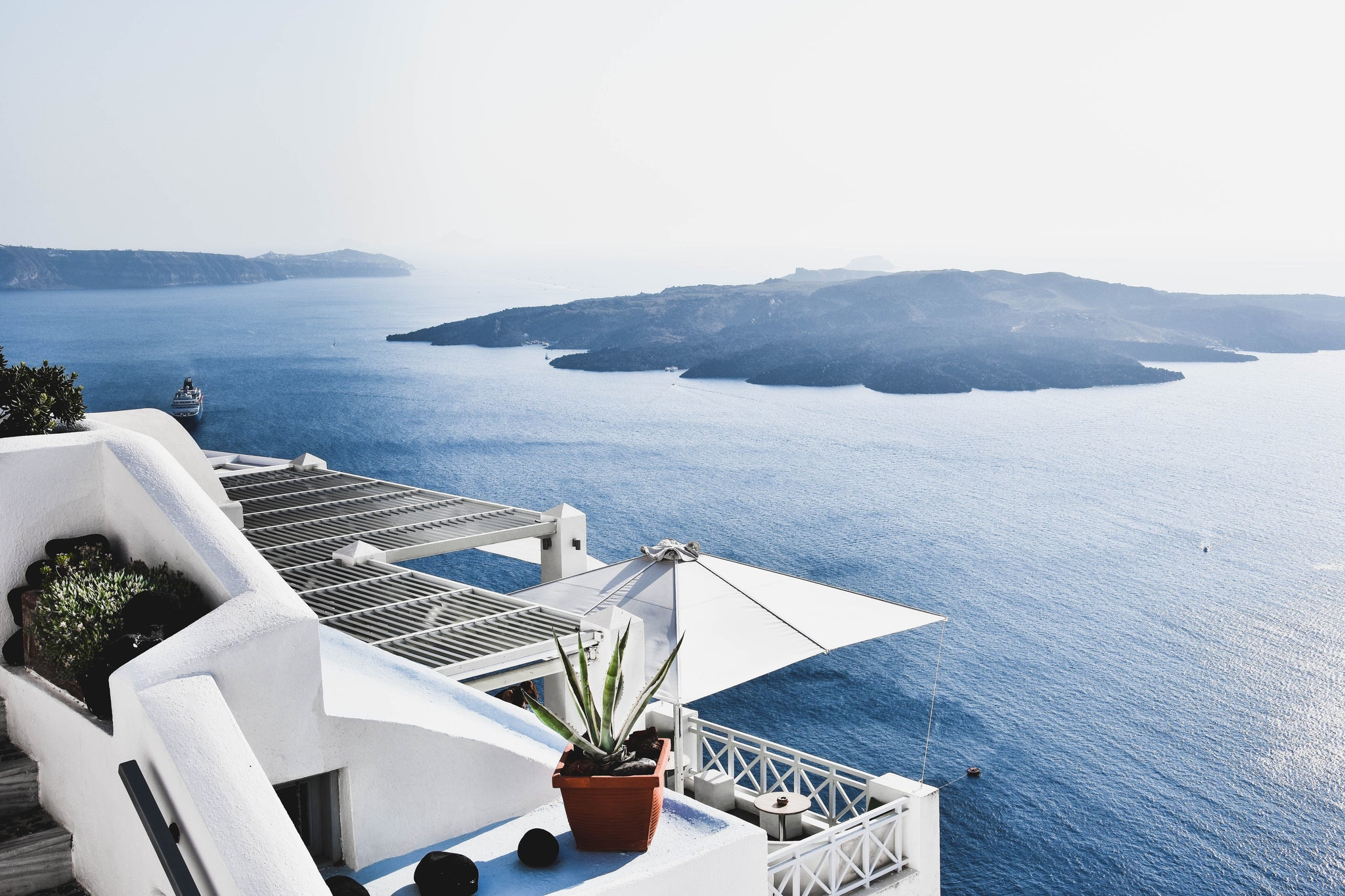 Santorini, Greece. White cliff and sea view. Barrels of London