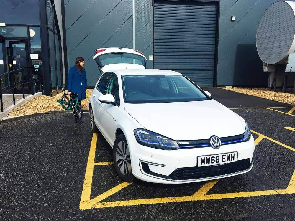 volkswagen e-golf, electric car, ev park and ride with kick scooter
