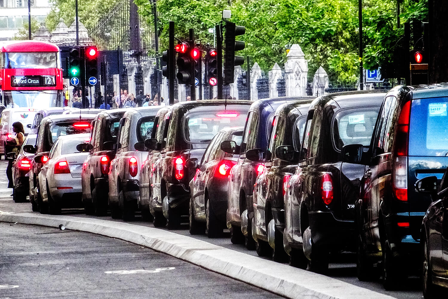 Queue of London taxis, traffic