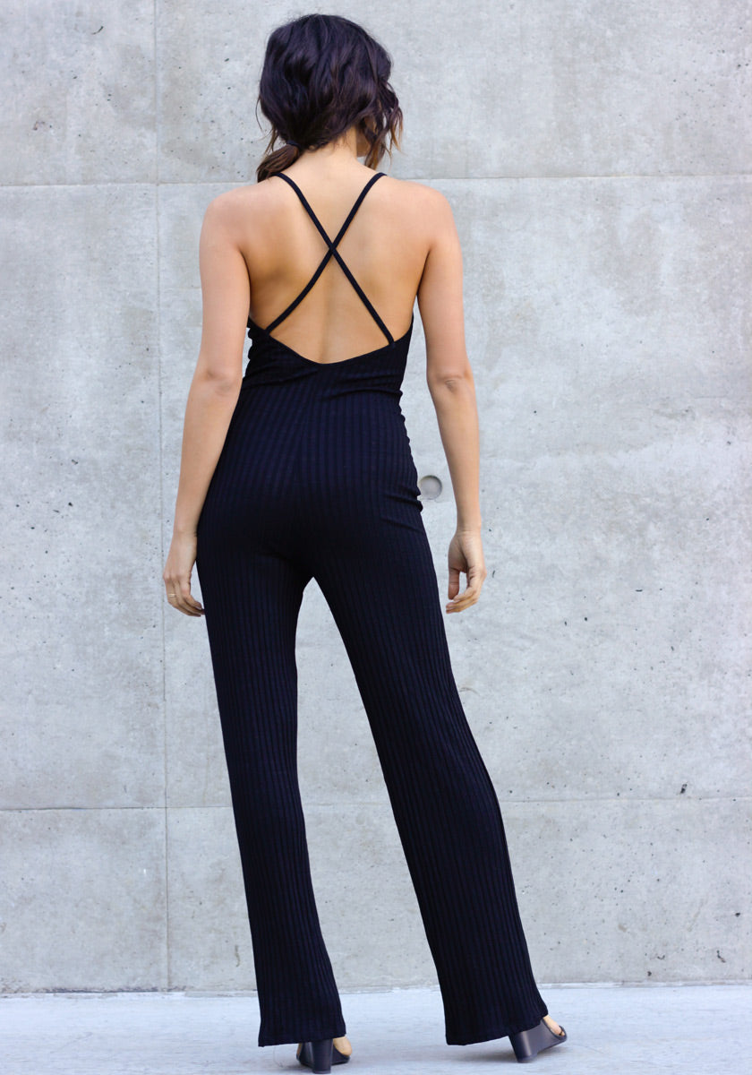 A Concrete Runway stretch ribbed jumpsuit with spaghetti straps, a crossover low back and straight legs