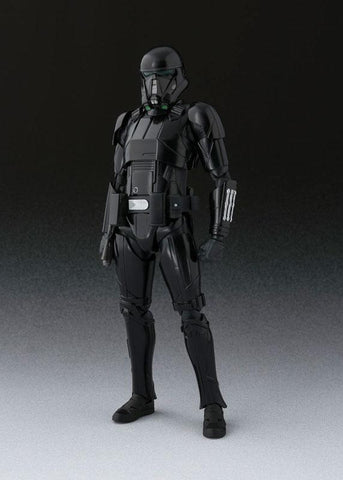 A black clone trooper standing action figure
