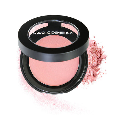 "Round Matte Black Component, clear round top window, filled with compressed round powder blush shade in ""American Beauty"" on top of loose powder swatch."