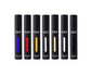 6 Black Matted tubes, vertical stretched oval windows, each filled filled with blue, red, yellow, silver metallic, gold metallic, white, and black liquid matte makeup.