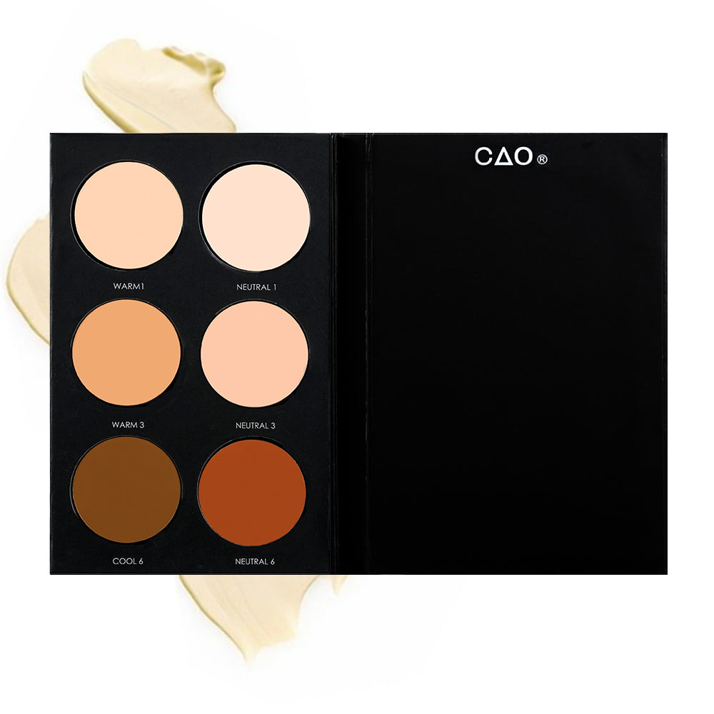 "Black Matte rectangular cardboard palette with 6 circular openings for ""Basic Foundation"" refill cream product in shades Warm 1, Neutral 1, Warm 3, Neutral 6, Cool 6, and Neutral6 on top of creamy swatch."
