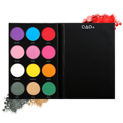 Black eyeshadow palette with 12 shades of circular compressed eyeshadows. From left to right, First row: purple, blue, red. Second Row: pink, bubblegum pink. Third row: white, yellow, orange. Last row: dark green, peach, bright green
