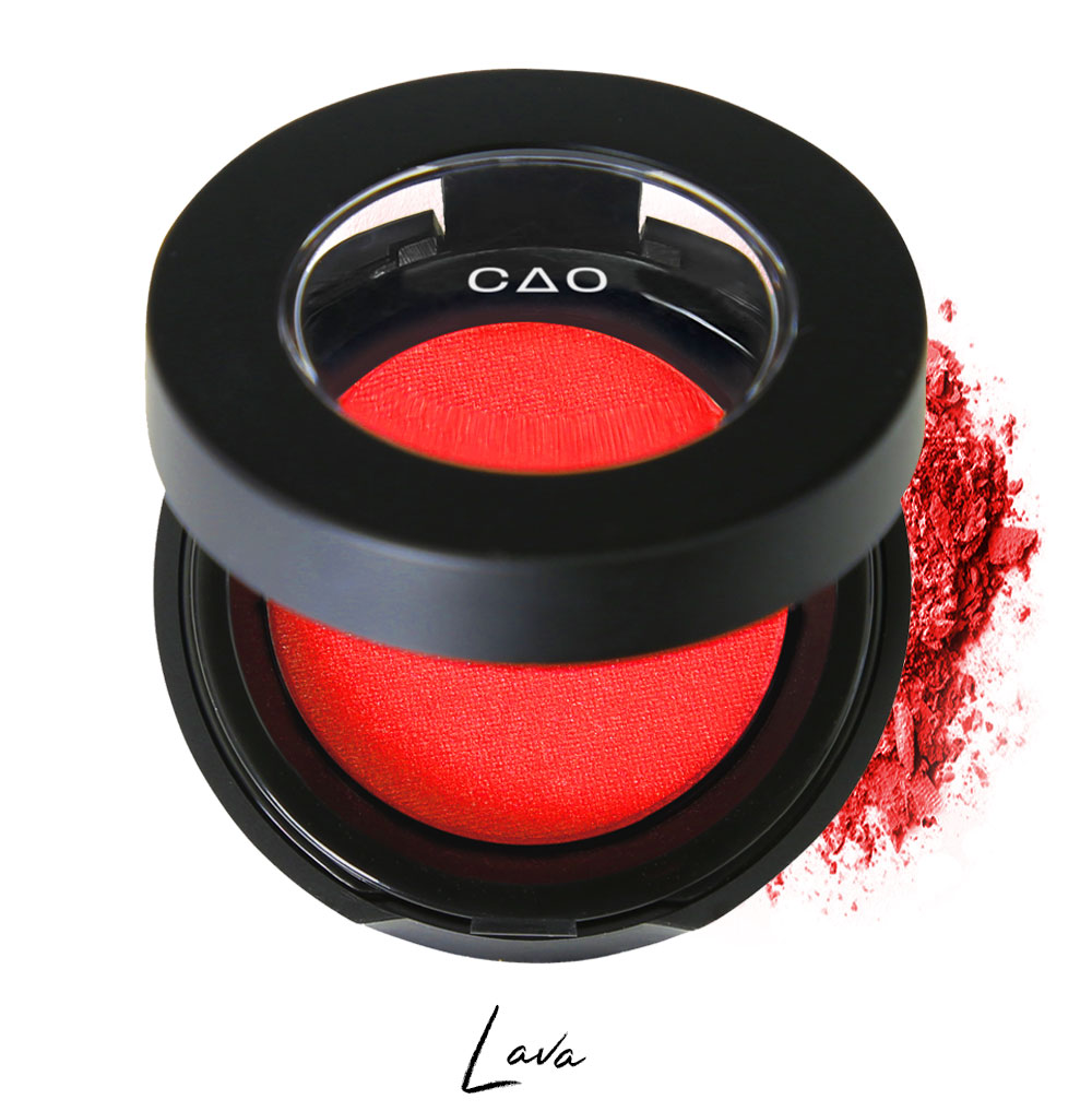 "Semi- open eyeshadow compact with bright red eyeshadow in shade ""lava"" compressed powder and on white background with loose eyeshadow powder on white.."